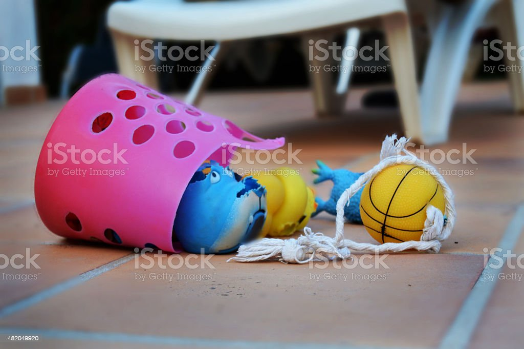 Pink basket with dog toys stock photo