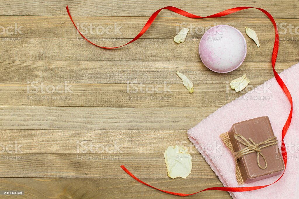 pink bath bomb and terry cloth towel  and soap stock photo