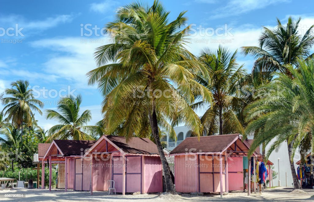 Pink beach huts on tropical Antigua island stock photo