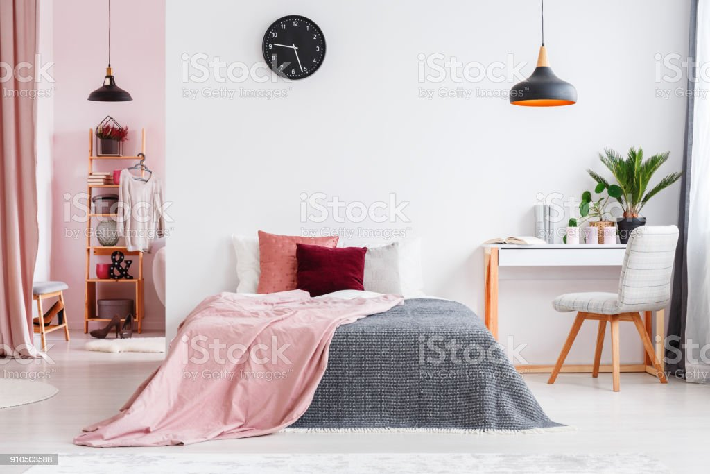 Pink bedroom interior with chair stock photo