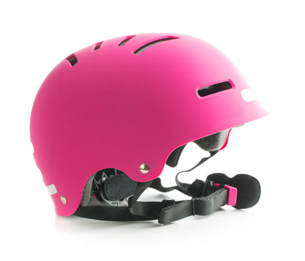 Pink bike helmet isolated on white background. - foto stock