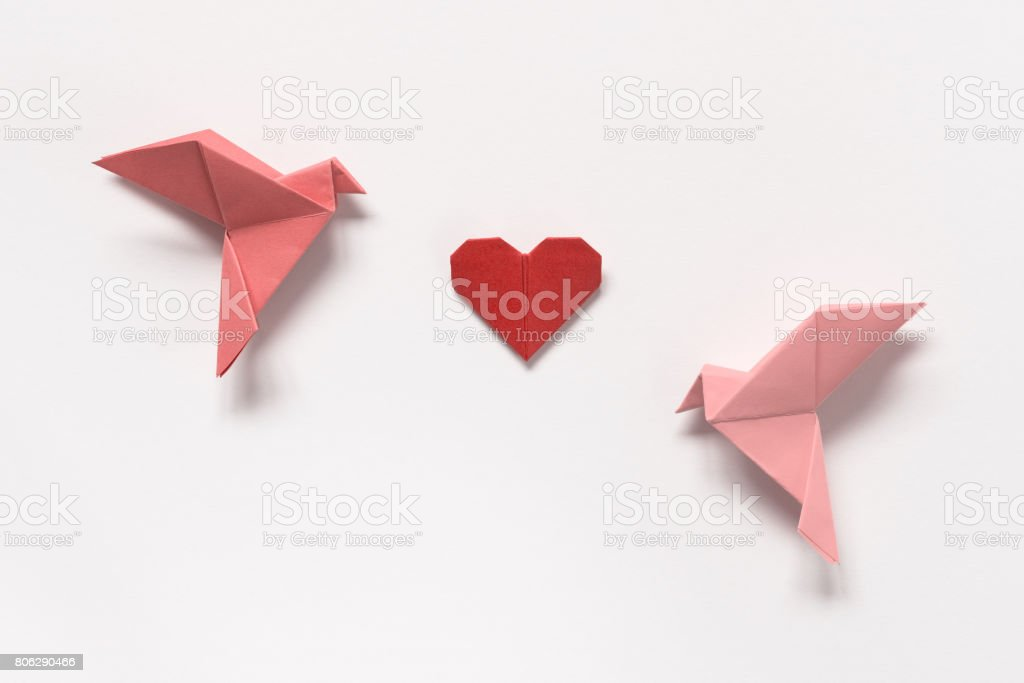 Pink Birds and Red Heart of origami on white background. Gift card for Valentine's Day. stock photo