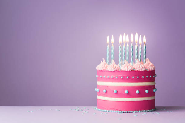 Pink birthday cake Pink birthday cake with nine candles birthday cake stock pictures, royalty-free photos & images