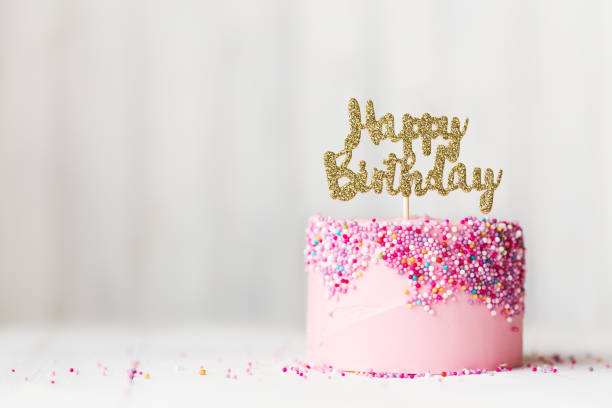 Pink birthday cake stock photo
