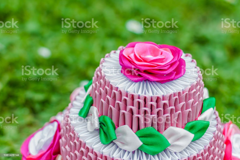Pleasing Pink Birthday Cake With 3D Origami On Green Grass Stock Photo Funny Birthday Cards Online Alyptdamsfinfo