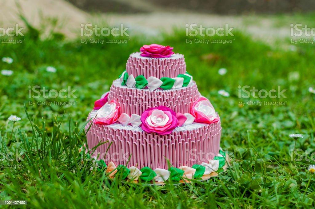 Awesome Pink Birthday Cake With 3D Origami On Green Grass Stock Photo Funny Birthday Cards Online Alyptdamsfinfo