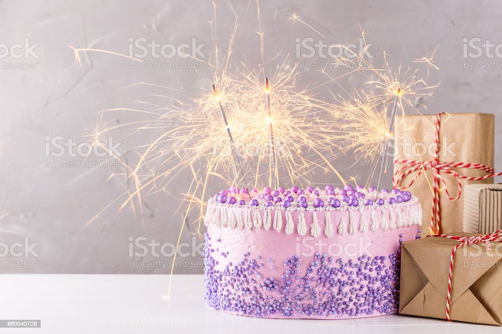 Pink Birthday Cake With Sparklers And Gift Boxes