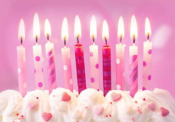 Pink birthday candles stock photo