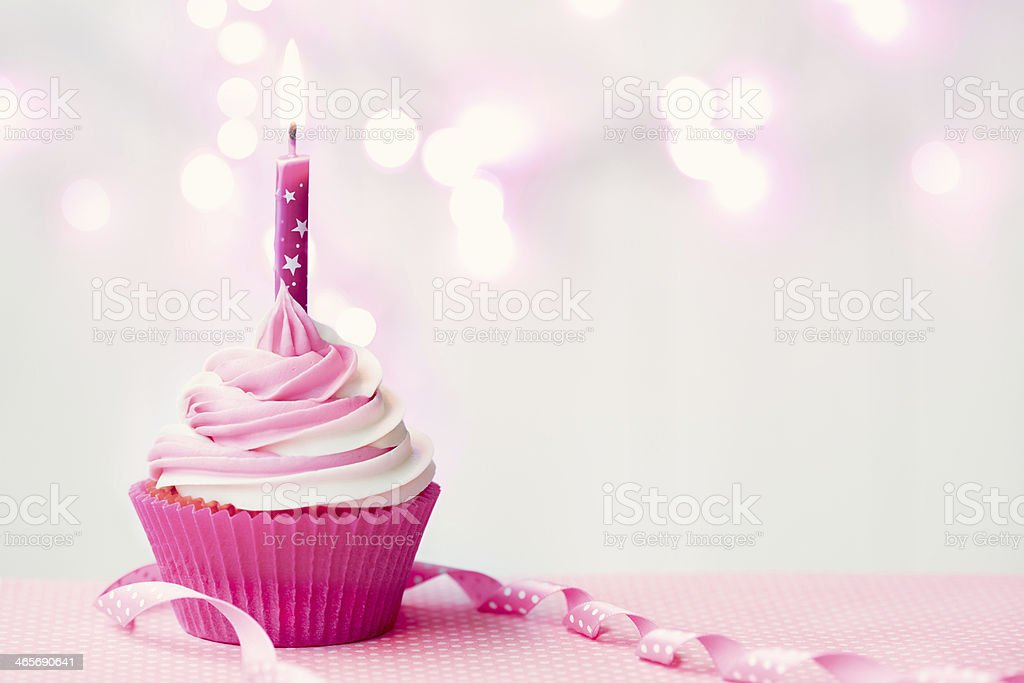 Pink birthday cupcake stock photo