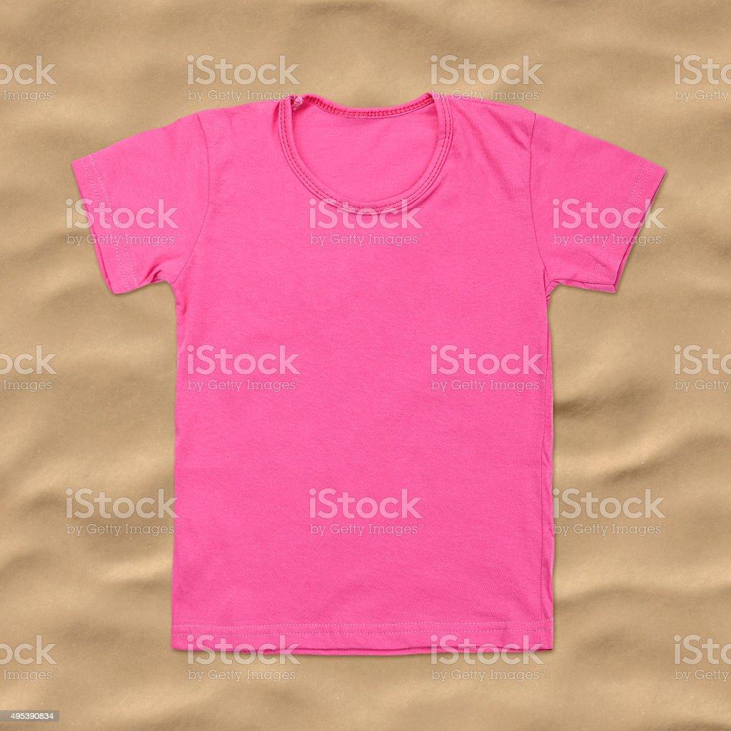 e5991032 Pink Blank Tshirt On Dark Sand Background Stock Photo & More ...