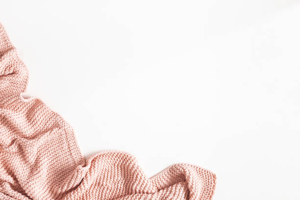 Pink blanket on white background. Flat lay, top view stock photo