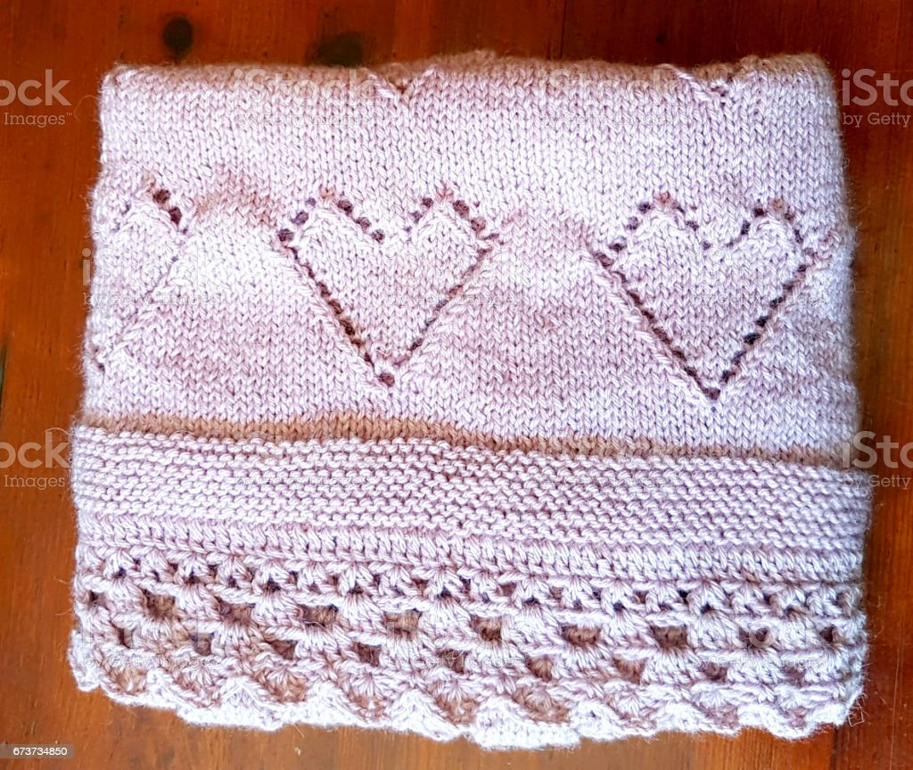 Pink blanket with decorations of hearts to stay warm photo libre de droits