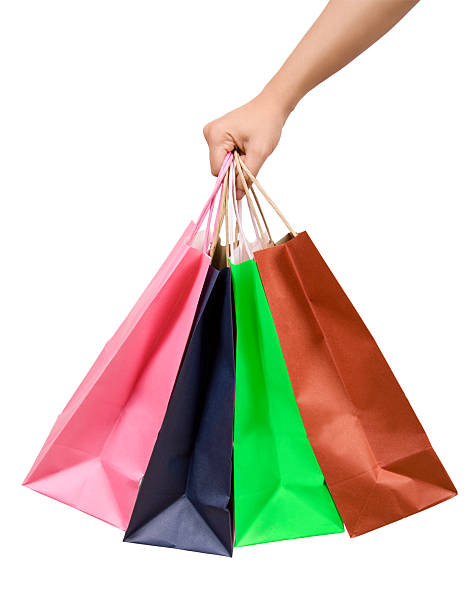 Pink, blue, green and brown shopping bags stock photo