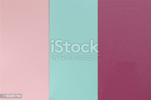 Pink blue violet color paper background. Geometric flat composition. Empty space on monochrome cardboard