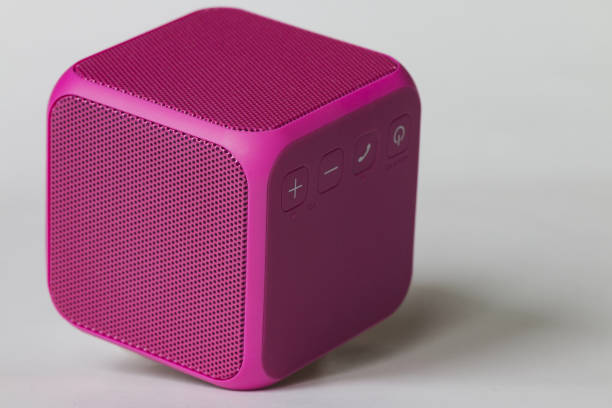 Pink bluetooth speaker cube on white background stock photo