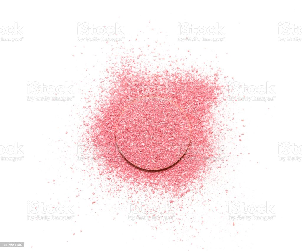 Pink blush scattered on a sponge, isolated on a white background. stock photo