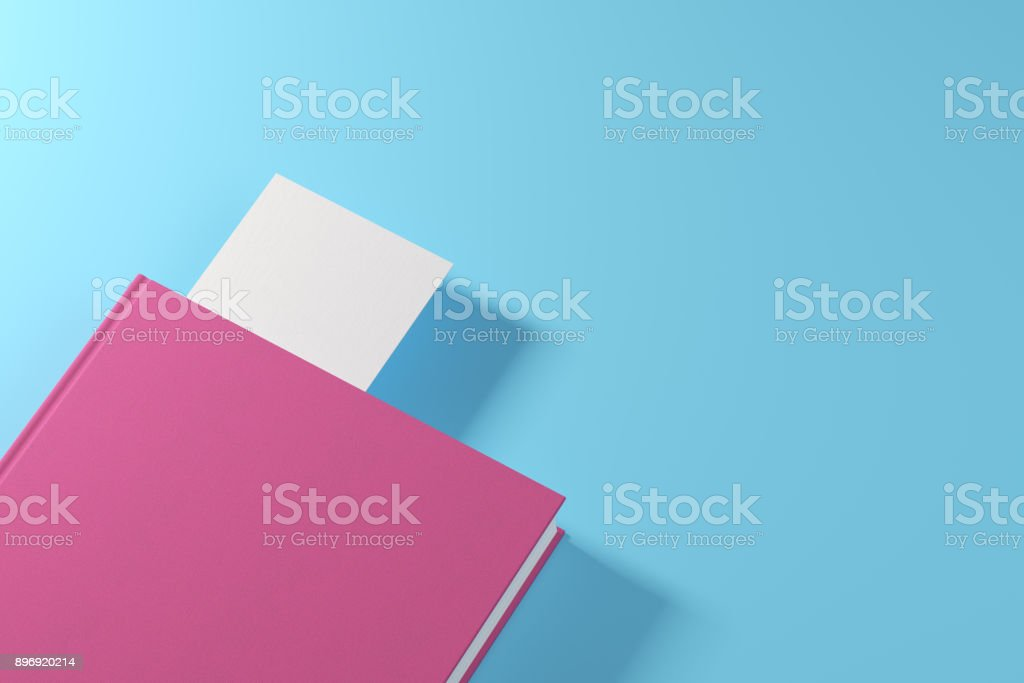 Pink book with white bookmark stock photo