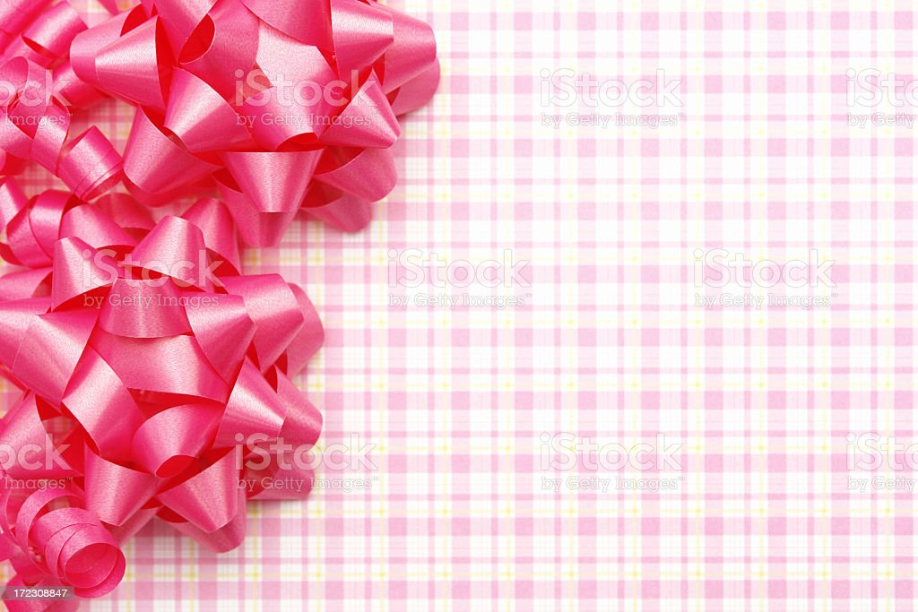Pink bow and ribbons on check pattern royalty-free stock photo