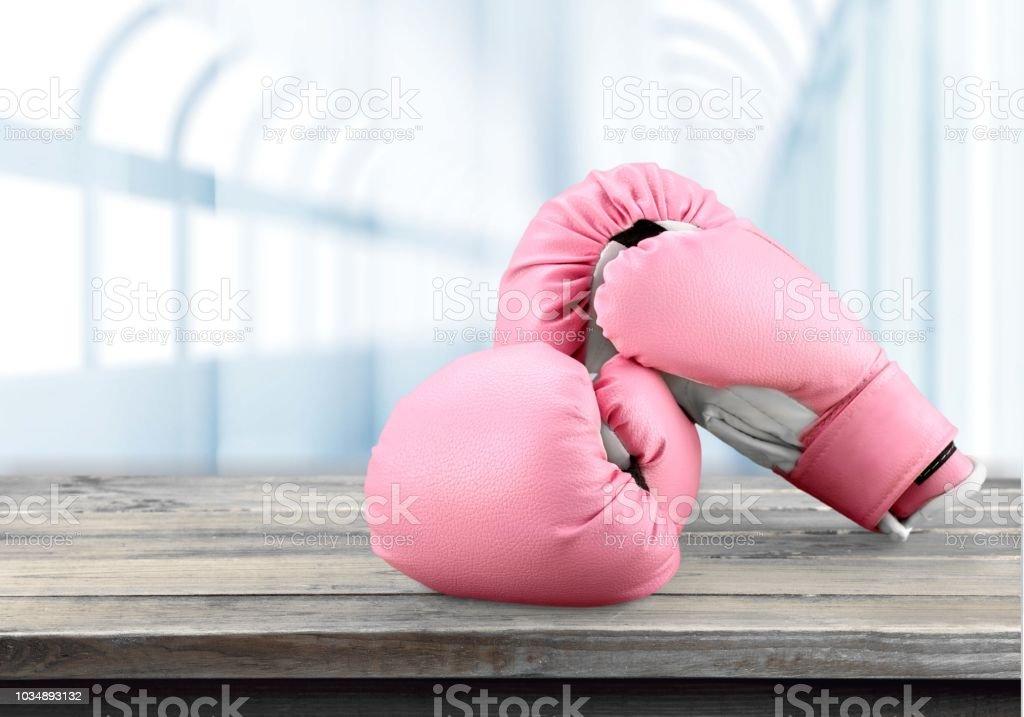 Rosa Boxhandschuh. – Foto