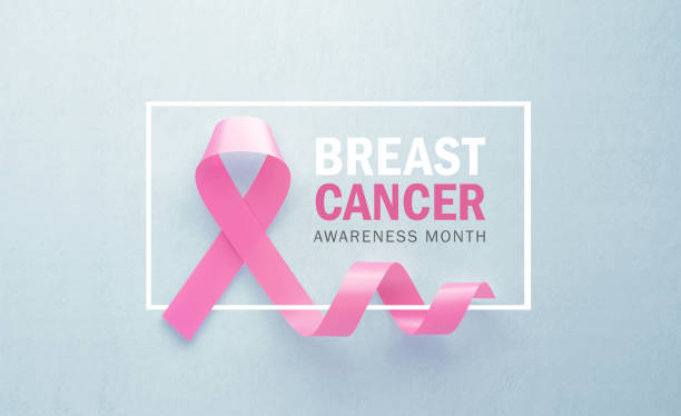 Pink Breast Cancer Awareness Ribbon Sitting Next to Brest Cancer Awareness Month Message on Gray Background Pink breast cancer awareness ribbon sitting next to breast cancer awareness month message on gray background. Horizontal composition with copy space. Breast cancer awareness concept. month stock pictures, royalty-free photos & images
