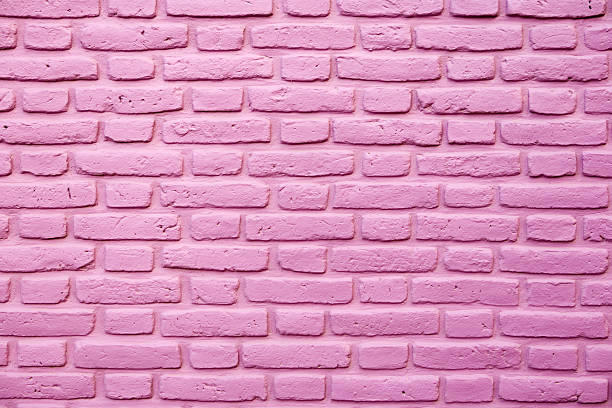 Pink brick wall texture stock photo