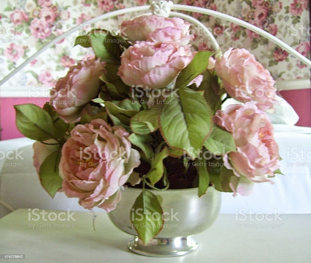 Pink Cabbage Roses in a Silver Vase stock photo