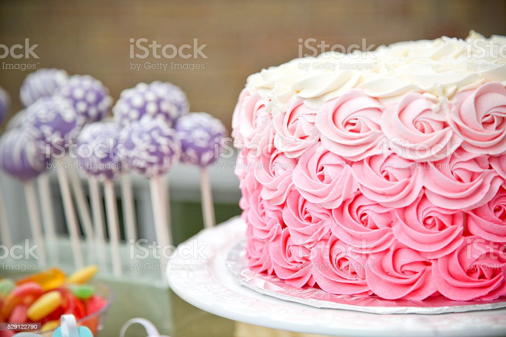 pink cake and cake pops stock photo