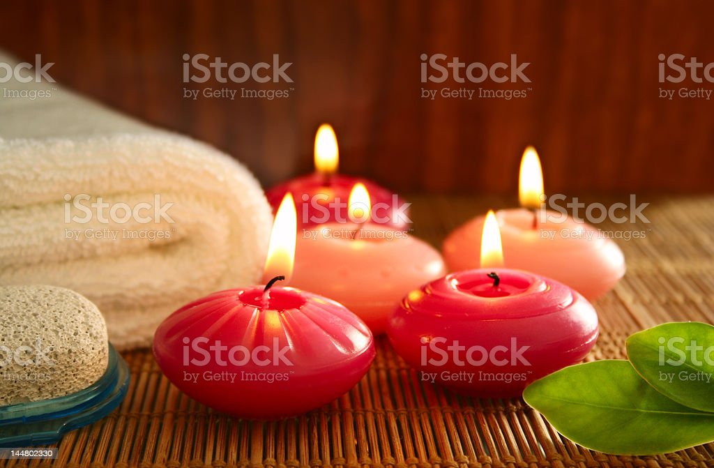 pink candles,pumice,towel and leaf royalty-free stock photo