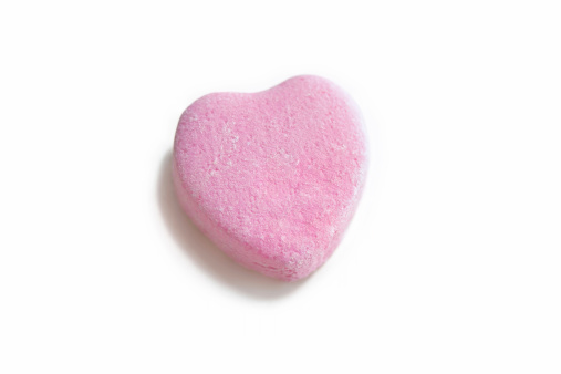 Isolated photo of a blank pink candy heart - perfect for inserting custom message.
