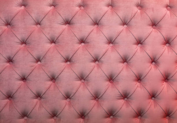 Pink capitone tufted fabric upholstery texture stock photo