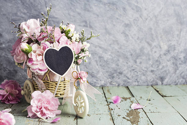Pink carnation in bicycle with blank wood heart picture id636604688?b=1&k=6&m=636604688&s=612x612&w=0&h=cwf hilby1joqnz ogtugzg6jy ueqjm4uzi7zbgn3g=