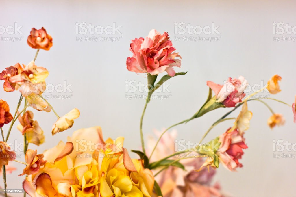 Pink Carnations And Orange Chrysanthemums In A White Vase Artificial