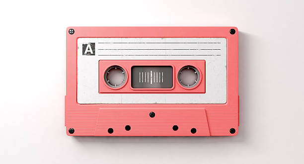 Pink Cassette Mix Tape A close up view of a pink vintage audio cassette tape with a white label that reads mix tape on an isolated white background audio cassette stock pictures, royalty-free photos & images