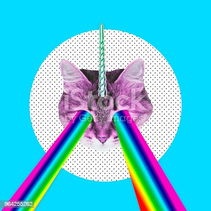 istock Pink cat with a unicorn horn emits a rainbow laser from eyes. 964255262