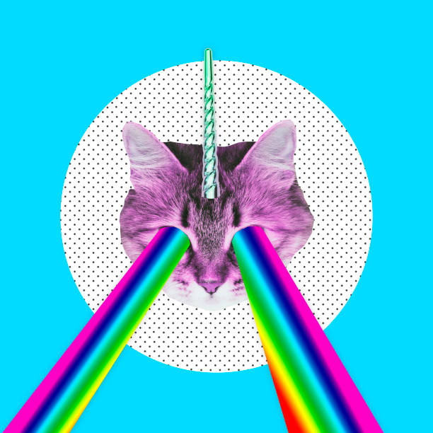 Pink cat with a unicorn horn emits a rainbow laser from eyes. stock photo