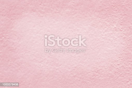 939873258 istock photo Pink cement wall texture for background and design art work. 1053379406