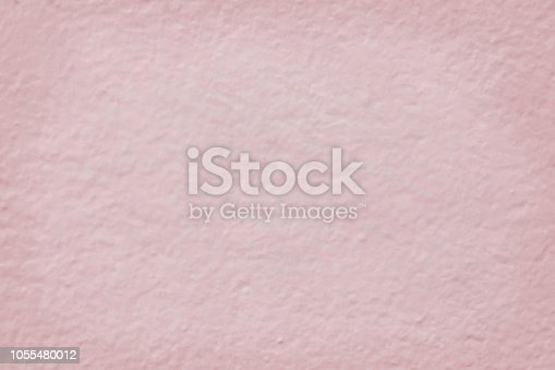 939873258 istock photo Pink cement wall texture for background and design art work. 1055480012