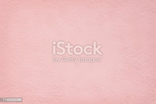 939873258 istock photo Pink cement wall texture for background and design art work. 1140535398