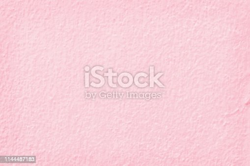 939873258 istock photo Pink cement wall texture for background and design art work. 1144487183