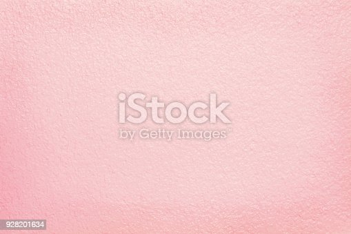 939873258 istock photo Pink cement wall texture for background and design art work. 928201634