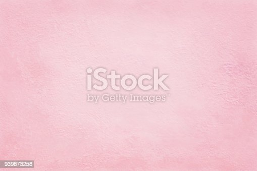939873258 istock photo Pink cement wall texture for background and design art work. 939873258