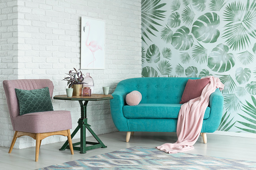 istock Pink chair and blue sofa 883741182