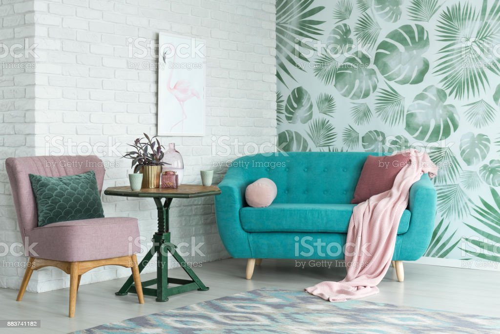 Pink chair and blue sofa stock photo