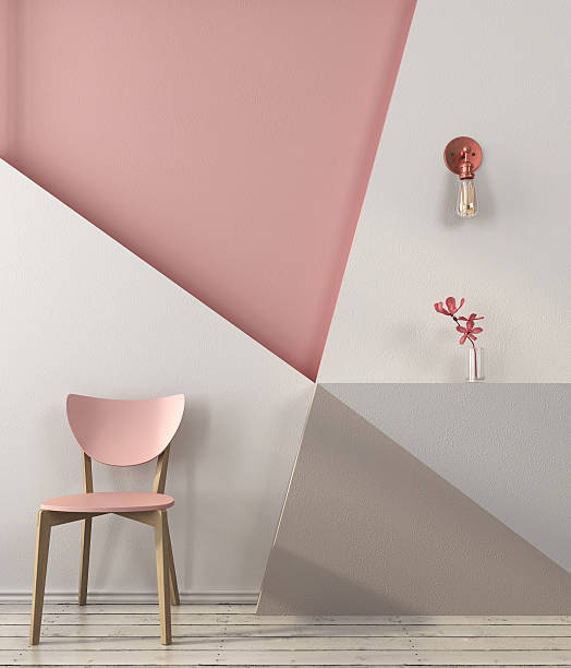 Pink chair on the background of a geometric wall stock photo