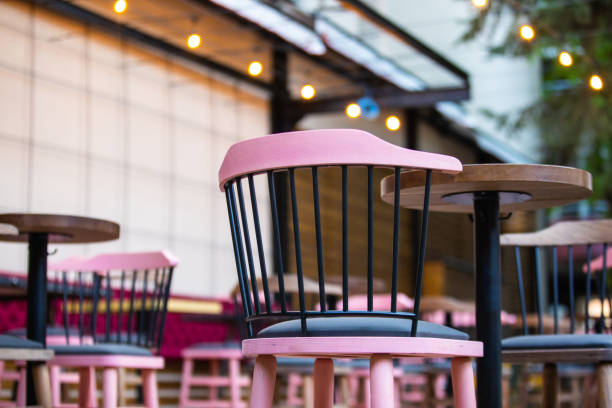 Pink chairs in sidewalk cafe stock photo