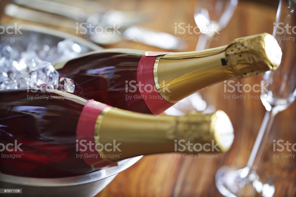 Pink champagne chilling in an ice bucket stock photo