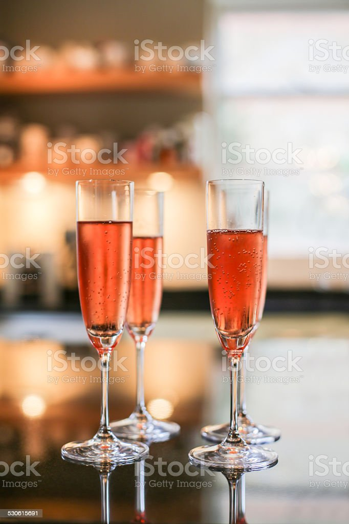 Pink Champagne flute glasses stock photo