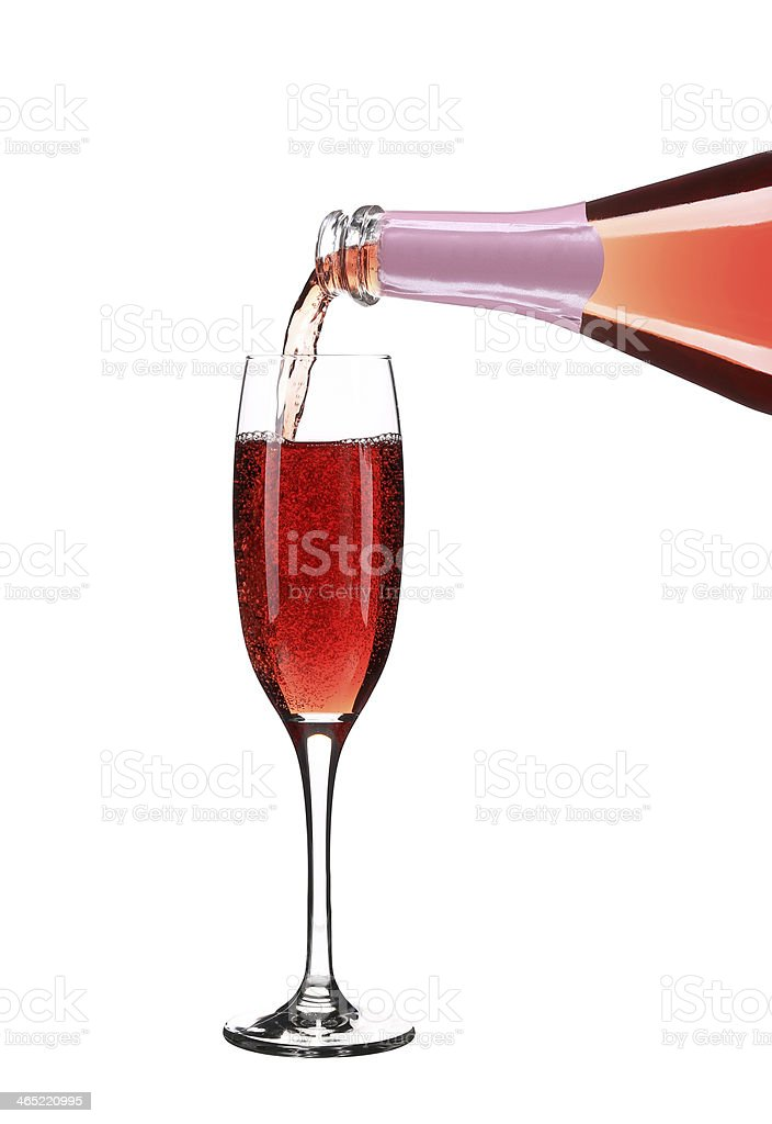 Pink champagne pouring in a glass. royalty-free stock photo