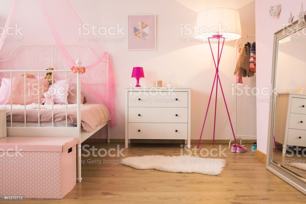 Pink child bedroom with lamp stock photo
