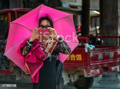599114758 istock photo Pink Chinese tourist in Shanghai 477862748